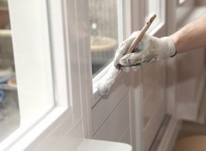 Hand of one of Capital City Painting interior painting experts.
